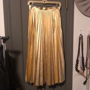 Pleated metallic gold skirt
